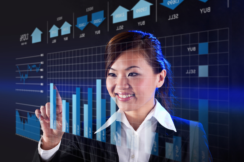 chinese business woman smiling with graph